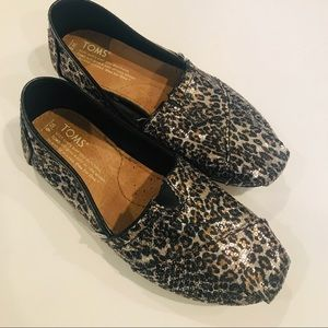 Toms sequined animal print slip ons.  Size 6W
